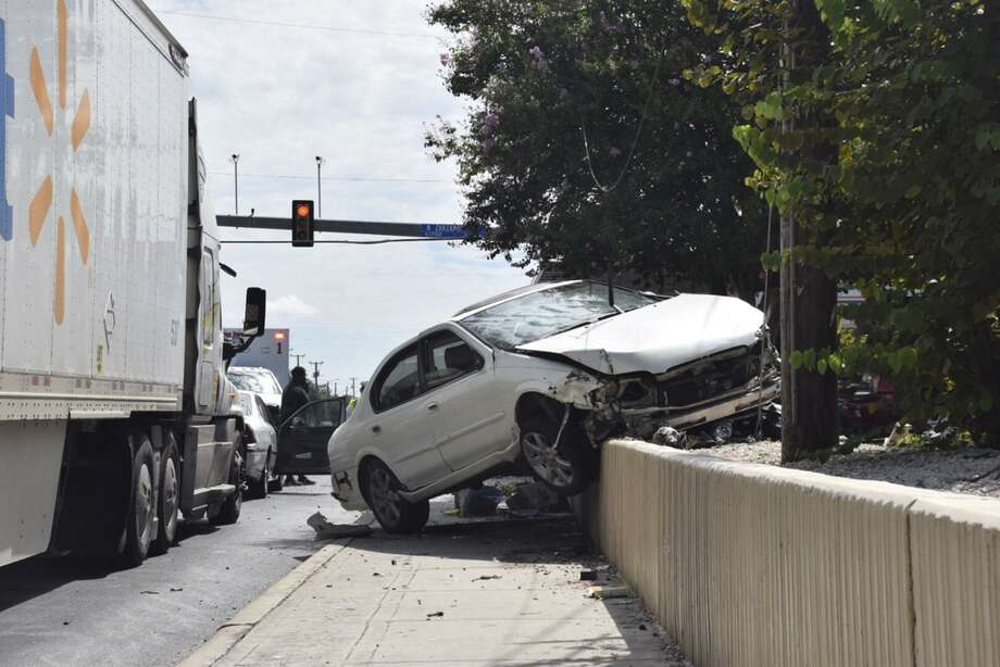 Four people were struck, including a pregnant woman, after a car plowed into a bus stop at Culebra Road and Zarzamora Street on Aug. 28. Speed and poor street design are common causes of most — if not all — crashes. Photo: Caleb Downs / Staff