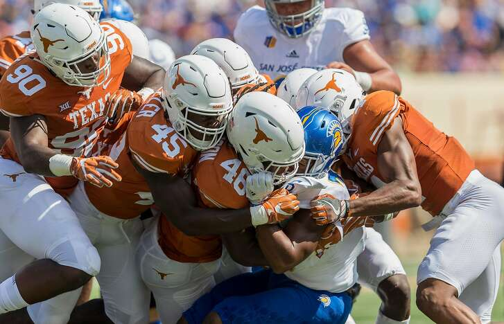 AUSTIN, TX - SEPTEMBER 09:  Tyler Nevens #23 of the San Jose State Spartans is gang tackled by Malik Jefferson #46 and the Texas Longhorns defense in the second half at Darrell K Royal-Texas Memorial Stadium on September 9, 2017 in Austin, Texas.  (Photo by Tim Warner/Getty Images)