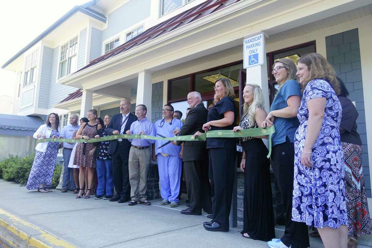 Medical personnel gather outside for a ribbon cutting ceremony at the newly opened St. Peter's Health Partners Urgent Care facility on Wednesday, Aug. 29, 2018, in Saratoga Springs, N.Y. (Paul Buckowski/Times Union)