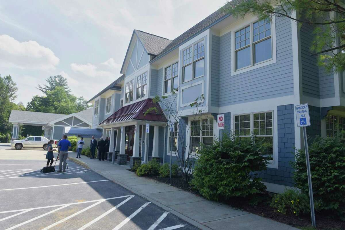 People gather for a ribbon cutting ceremony at the newly opened St. Peter's Health Partners Urgent Care facility on Wednesday, Aug. 29, 2018, in Saratoga Springs, N.Y. (Paul Buckowski/Times Union)