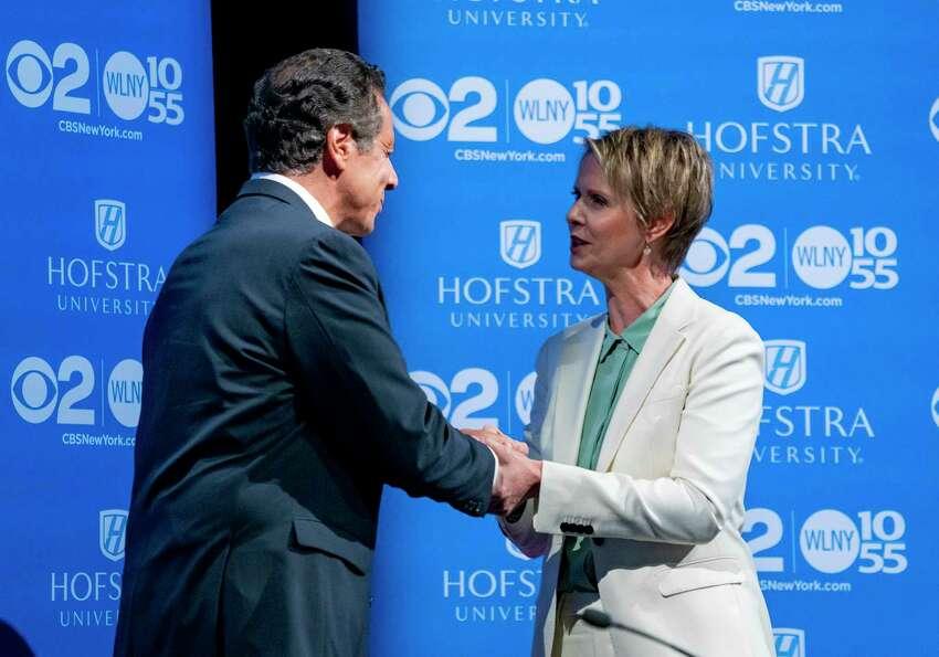 New York Gov. Andrew Cuomo, left, shakes hands with Democratic New York gubernatorial candidate Cynthia Nixon before their debate at Hofstra University in Hempstead, N.Y., Wednesday, Aug. 29, 2018. (AP Photo/Craig Ruttle, Pool)