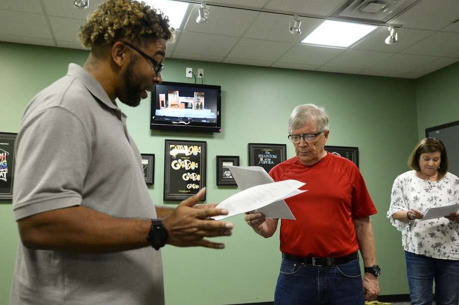"""T.J. Scott and Mike Rodgers read parts during auditions for the reading of """"Stuck in RV Land"""" by local playwright Patricia Barry Rumble at Beaumont Community Players. The stage reading will be performed at 6:30 p.m. Sept. 16. Photo: Ryan Pelham / The Enterprise / ©2018 The Beaumont Enterprise"""