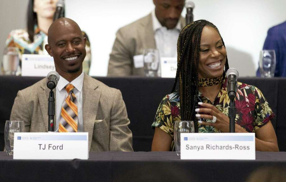 Former NBA player T.J. Ford, left, shares a laugh with Olympic gold medalist Sanya Richards-Ross during the Going Pro sports forum at The Woodlands Country Club on Wednesday, Aug. 29, 2018, in The Woodlands. The annual event comprised of athletes, health care providers and others from the sports industry offered advice and answered questions about college recruitment and competing at the professional level. Photo: Jason Fochtman, Houston Chronicle / Staff Photographer / © 2018 Houston Chronicle