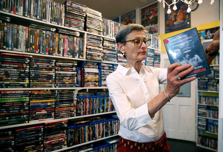 Coral Reiff browses through the DVD collection at Video Wave in San Francisco. Reiff tries to visit the store every day it's open. Photo: Photos By Paul Chinn / The Chronicle