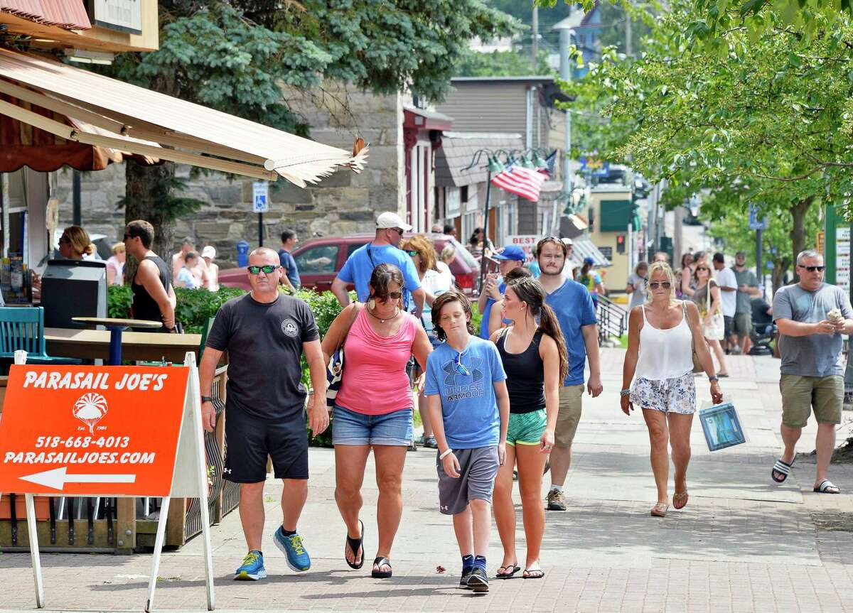 Tourists fill the sidewalk along Canada Street Thursday July 5, 2018 in Lake George, NY.(John Carl D'Annibale/Times Union)