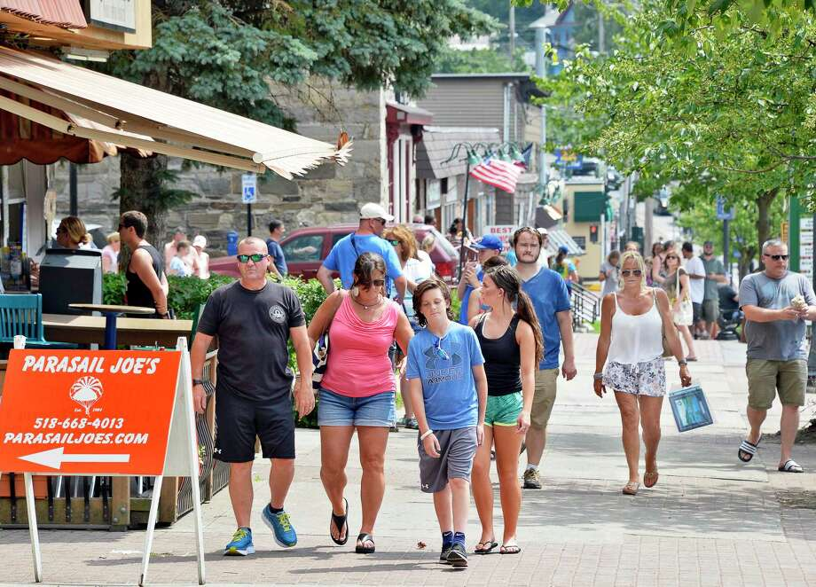 Tourists fill the sidewalk along Canada Street Thursday July 5, 2018 in Lake George, NY.(John Carl D'Annibale/Times Union) Photo: John Carl D'Annibale