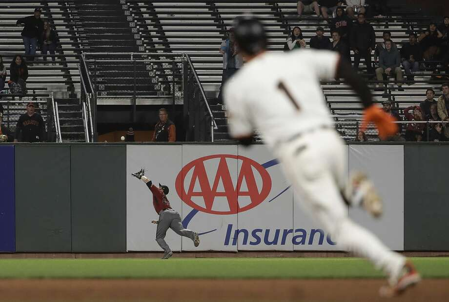 Diamondbacks right fielder Steven Souza Jr., catches a flyball hit by Gregor Blanco in the sixth inning. Photo: Jeff Chiu / Associated Press