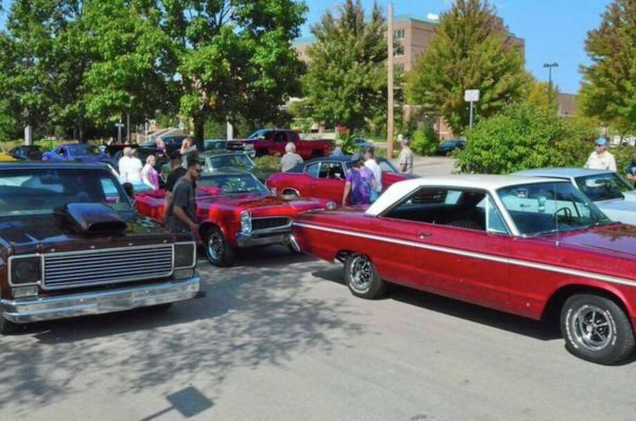 (ABOVE) Cars, cruise participants and spectators await the start of one of the annual Midland cruises organized annually by the Midland Cruise 'N Car Show committee of volunteers. The 29th annual Midland Cruise 'N Car Show will be Sept. 15-16. The Saturday cruise starts in the Farmers Market parking lot at the foot of Ashman Street. (RIGHT) 2018 t-shirt design. (photos provided)