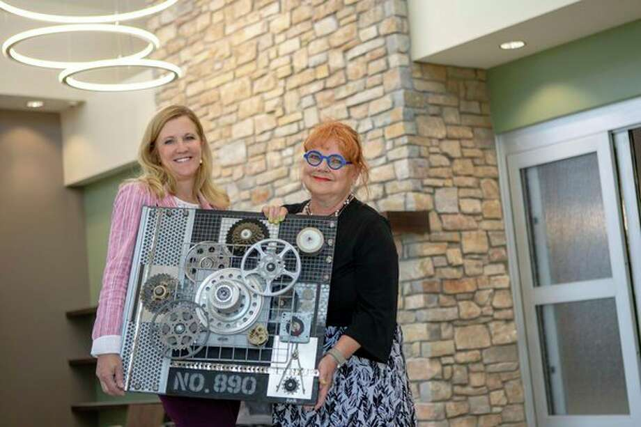 The new MidMichigan Health Park - Bay has partnered with a local art institution, Studio 23, to bring community culture and history into its design. Cheryl Yesney, director, MidMichigan Physicians Group, and Valerie Allen, curator at Studio 23, hold a piece of the facility's new artwork that represents the Industrial Works era in Bay City. MidMichigan Health Park - Bay, located at 3051 Kiesel Road in Bay City, opens in September. (photo provided)