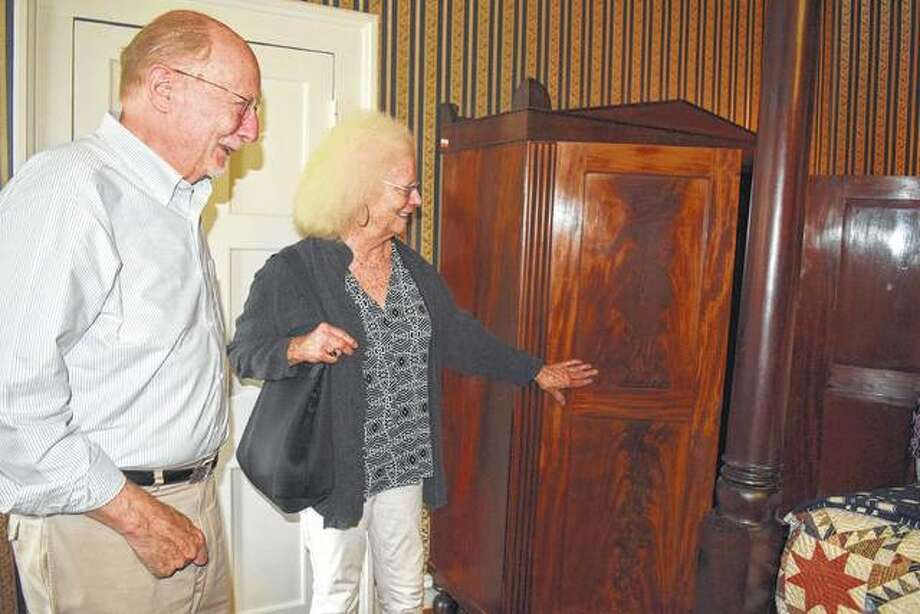 Putnam Barber (left), a descendant of Gov. Joesph Duncan, and Valerie Lynch, both of Seattle view the Gov. Duncan Mansion for the first time Wednesday, including the placement of an armoire the couple donated to the Mansion. Photo: Samantha McDaniel-Ogletree | Journal-Courier