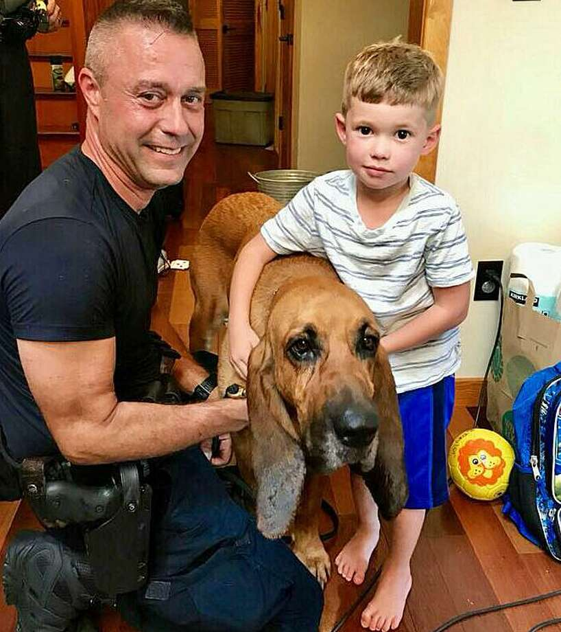 State Trooper Ed Anuszewski, K9 Texas and Blake Taylor after the 4-year-old boy, who was believed missing. The handler Anuszewski ) took a small piece of my son's pillow case for the dog to get his scent. The boy was found sleeping in the house under cushions. In December, K9 Texas was lost in the woods for two days. He was found alive and well in a massive search. Photo: State Police Photo Via Facebook.