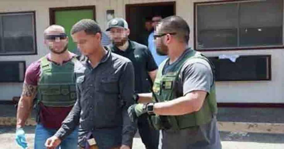 Agents from Border Patrol and Homeland Security Investigations rescue undocumented immigrants Wednesday held against their will at a local hotel. Photo: Border Patrol