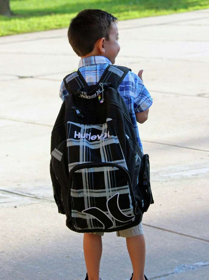 A McKinley Elementary School student totes a backpack that's almost as big as he is Thursday, the first day of school. Fairfield,CT. 8.30.18 Photo: Genevieve Reilly / Hearst Connecticut Media / Fairfield Citizen