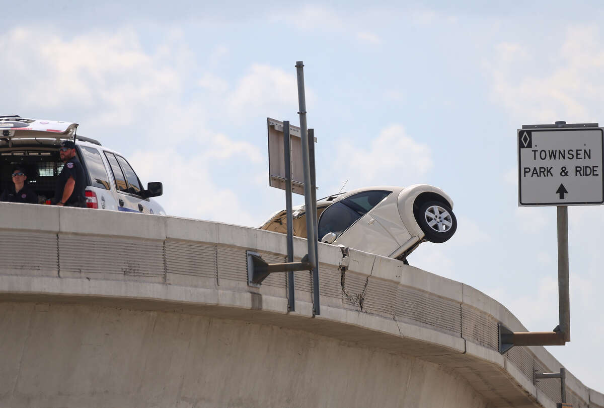 Authorities investigate the scene of single-vehicle crash on the Interstate 69 HOV off-ramp near Townsen Boulevard Tuesday, June 12, 2018, in Humble, Texas.
