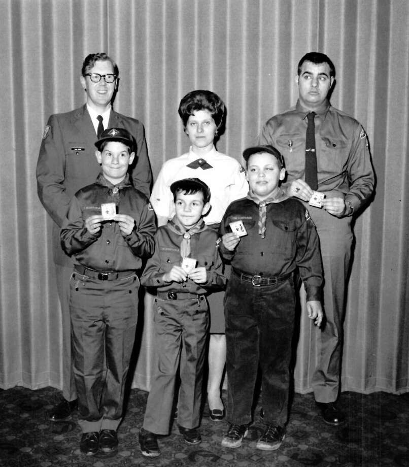 Scout Night at Civitan Club. Among Scouts honored are, from left, Cub Scouts Tony Naples, Jamie Pitts and Eddie Braley of Cub Pack 18. In back, from left, Paul Price, Chippewa District Scout executive in charge of program, Mrs. Patrick Naples, den mother, and Richard Stuff, assistant Scoutmaster. February 1969 Photo: Daily News File Photo