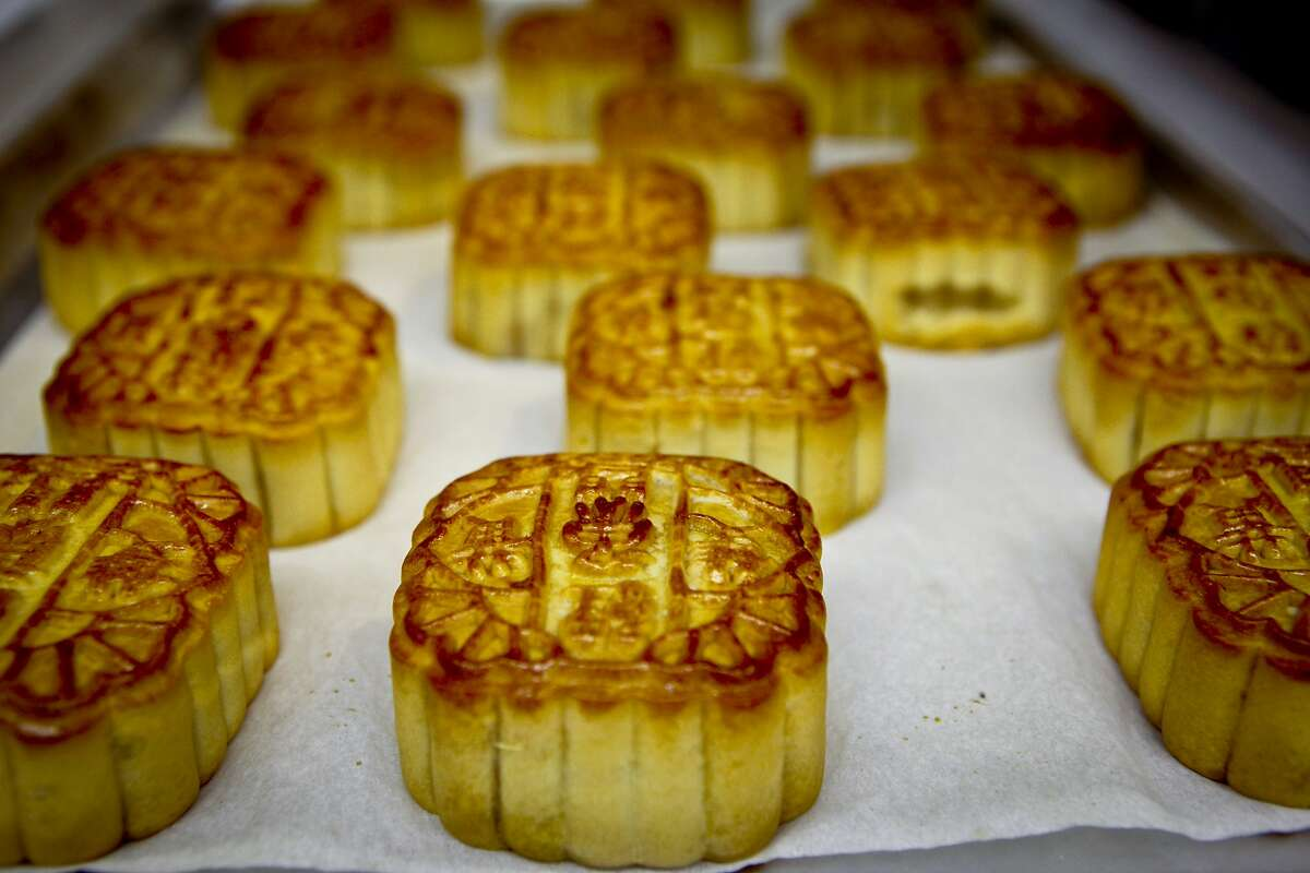 Mooncakes made for Koi Palace restaurant are seen on a cooling tray at Magic Gourmet Trading Inc. in Millbrae, Calif., on Tuesday, Aug. 23, 2011.