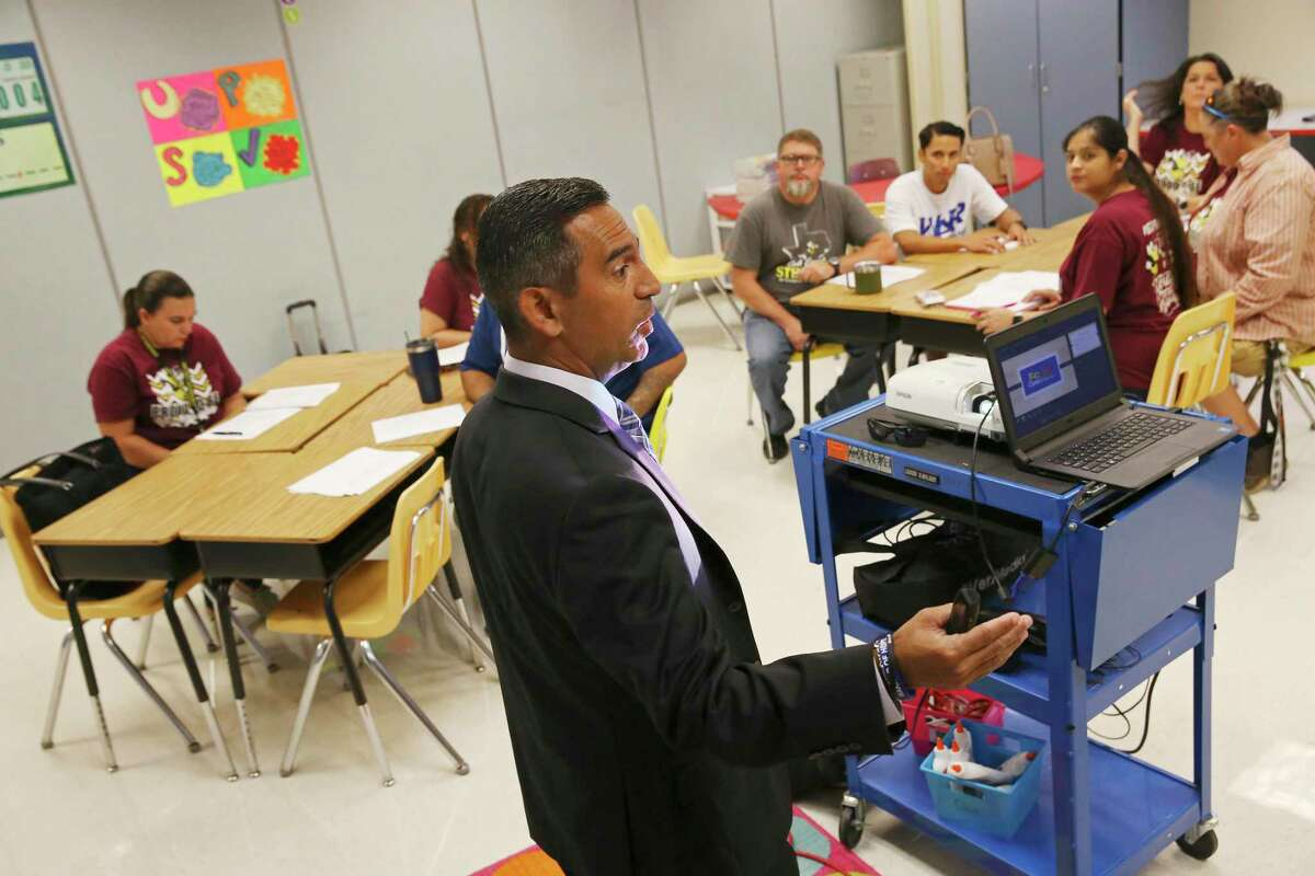 Johnny Hernandez, East Central Independent School District's director of student service, speaks to the staff at Oak Crest Elementary School on Aug. 23, 2018. East Central has been identifying students facing adversity through its EC Cares program. They said Handle With Care allowed the district to respond more quickly and deliberately to those students.