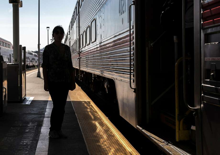 Odalys Vallejo, silhouetted at Caltrain's San Francisco Station, says the investigation is a sign that women's sexual assaults are not treated seriously enough. Photo: Jessica Christian / The Chronicle