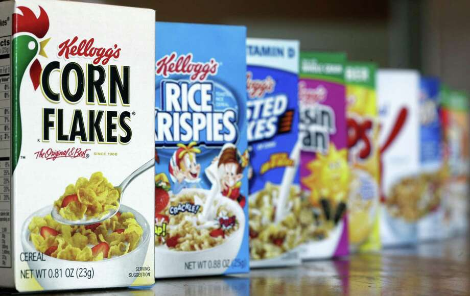 "FILE - This Feb. 1, 2012, file photo, shows Kellogg's cereal products, in Orlando, Fla. On its website, amid news of Pop-Tarts and Frosted Flakes, Kellogg touted a distinguished-sounding ""breakfast council"" of ""independent experts"" dedicated to guiding its nutritional efforts. Nowhere did it say that Kellogg paid the council members and spoon-fed them talking points about the benefits of cereal and breakfast, according to a copy of a contract and email exchanges obtained by The Associated Press. (AP Photo/John Raoux, File) Photo: John Raoux / Associated Press / A2012"