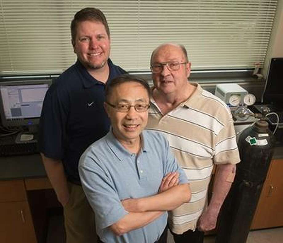 SIUE College of Arts and Sciences Department of Chemistry faculty Drs. Yun Lu (front), Kevin Tucker (left), and James Eilers (right) are collaborating on research funded by the NSF.