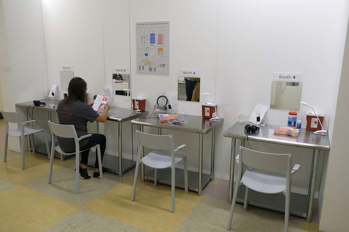 In this photo taken Wednesday, Aug. 29, 2018, are booth injection stations at Safer Inside, a realistic model of a safe injection site in San Francisco. The model is an example of a supervised, indoor location where intravenous drug users can consume drugs in safer conditions and access treatment and recovery services. (AP Photo/Eric Risberg)