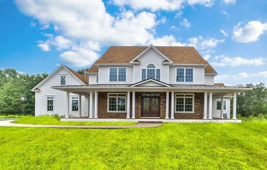 The custom-built home at 42 Starr Lane in Bethel, which recently sold for $949,900, broke the record for the highest priced sale in the last 10 years for the town. The house was built on one of 12 lots that make up Deer Run Estates, a group of properties owned by Gama Developers, who custom build each home using their in-house design and architect team. Photo: Brian Zuleta / Contributed Photo / @Brian Zuleta