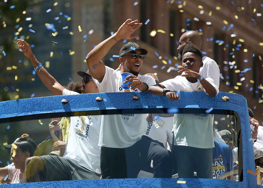 David West greets fans on Broadway at 20th during the Warriors' victory parade in June. Photo: Liz Hafalia / The Chronicle