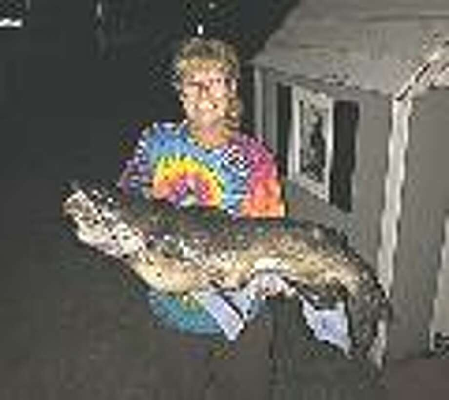 Karen Nentwig, of Midland, caught this 40 3/4-inch channel catfish from a kayak on Hamlin Lake, near Ludington, on Aug. 10. It was only 3/4 inch short of the state record, which was set in 1964. (Photo provided by Karen Nentwig)