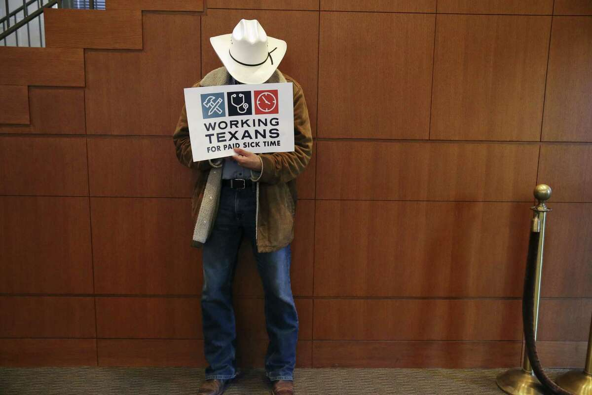 A man shows his support during a public hearing on the proposal for a citywide paid sick leave ordinance at the San Antonio City Council Chambers, Wednesday, August 8, 2018. Of the 136 who signed up to speak, 17 were against the ordinance.