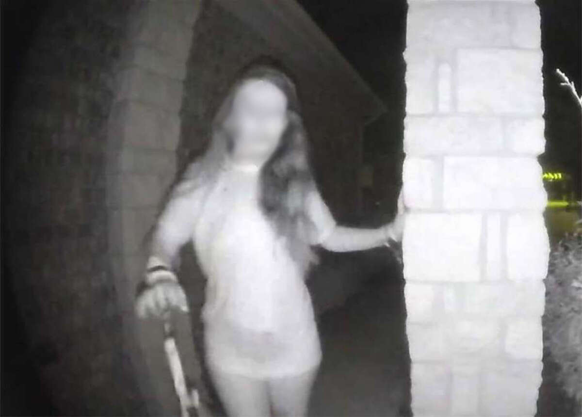 The woman was first seen on a security camera early Friday as she rang a doorbell at a home. Police suspected she may have had broken restraints on her wrist.