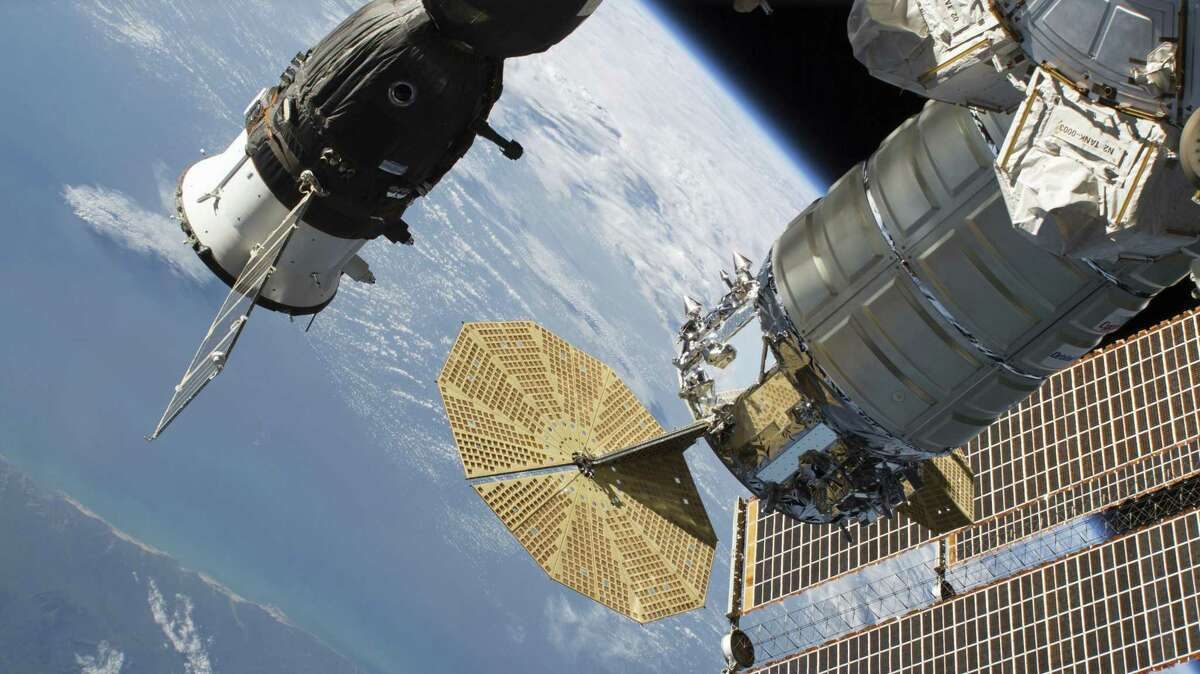 In this June 24, 2018 photo released by NASA, the Russian Soyuz MS-09 crew craft, left, and the Northrop Grumman (formerly Orbital ATK) Cygnus space freighter are attached to the International Space Station. NASA and Russian space officials stressed Thursday, Aug. 30, 2018, that the six astronauts are in no danger after a small air leak developed in one, at left, of the two Soyuz capsules docked at the space station.