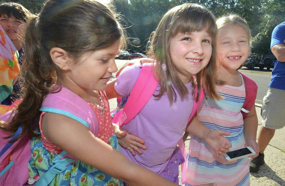 Best friends going back to school, Eve Magnone, Maddie Paradise and Molly Lawrence all going into the first grade at Cranbury School on the first day back for students in Norwalk Conn. on Wednesday August 29, 2018 Photo: Alex Von Kleydorff / Hearst Connecticut Media / Norwalk Hour