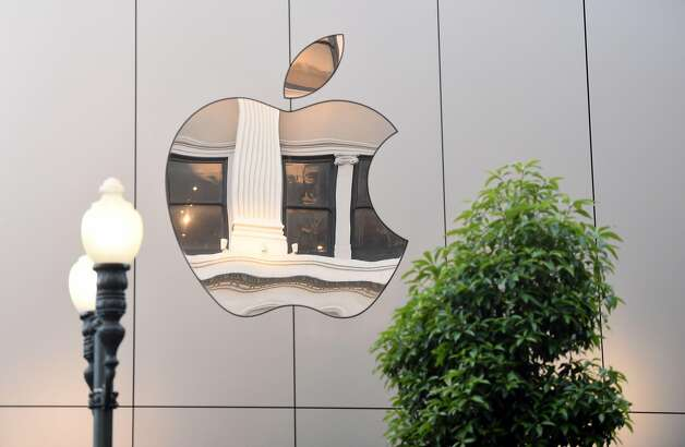 """Apple: Staffers may begin to return to the office as early as late May, early June. Apple's plan sees workers heading back into the office earlier than the others. Some staffers who cannot work remotely are already onsite, and as Bloomberg reported, """"[That] will expand to major offices across late May and early June, Apple has told staff."""" Photo: JOSH EDELSON, AFP/Getty Images"""