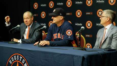 Houston Astros owner Jim Crane, manager AJ Hinch and GM Jeff Luhnow during a press conference announcing Hinch's contract extention before the start of an MLB baseball game at Minute Maid Park, Thursday,  August 30, 2018, in Houston.