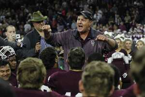 Cy Fair head coach Ed Pustejovsky addresses the team after the high school football semifinal playoff playoff game between Austin Westlake and Cy Fair at NRG Stadium in Houston, on Saturday, December 16, 2017.
