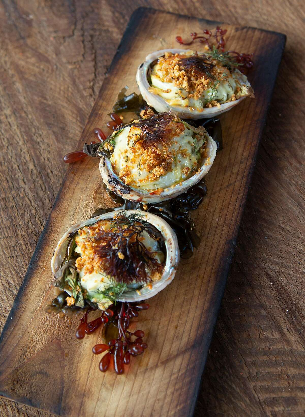 Monterey Bay Abalone Rockefeller includes various seaweeds grown by Monterey Bay Seaweeds in Moss Landing and is one of the menu items at Home restaurant on Wednesday, 8/8, 2018 in Soquel, California.