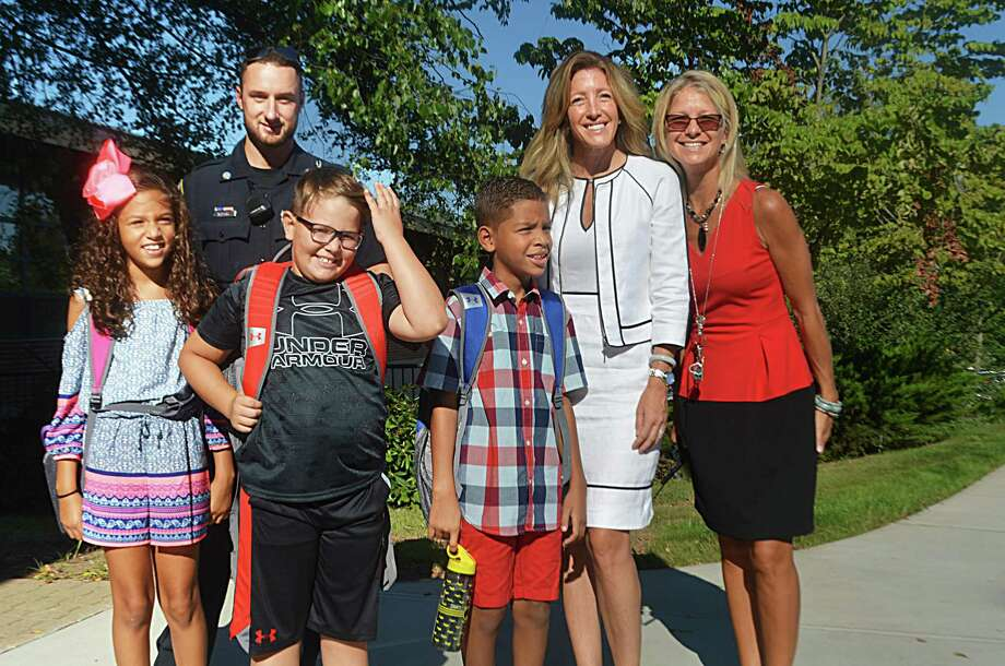Thursday was the first day of the 2018-19 academic year in Middletown. From left are third-grader Taryn, Middletown Police Officer Ben Murphy, fourth-graders Brody and Braylan, Wilbert Snow Elementary School Principal Jennifer Cannata and Elementary Instructional Support Teacher Colleen Fitzpatrick. Photo: Cassandra Day / Hearst Connecticut Media
