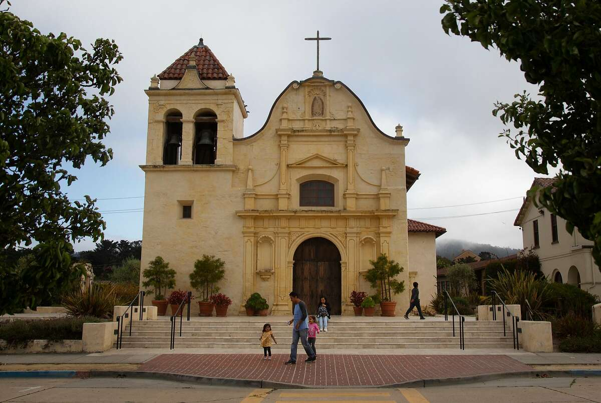 Tourists visit San Carlos Cathedral on Monday, 7/30, 2018 in Monterey, California. Local historian Tim Thomas recommends the cathedral to visitors who are interested in Monterey's history. The cathedral is the oldest continuously operating parish and the oldest stone building in California. It was built in 1794 making it the oldest (and smallest) serving cathedral along with St. Louis Cathedral in New Orleans, Louisiana. It is the only existing presidio chapel in California and the only existing building in the original Monterey Presidio.