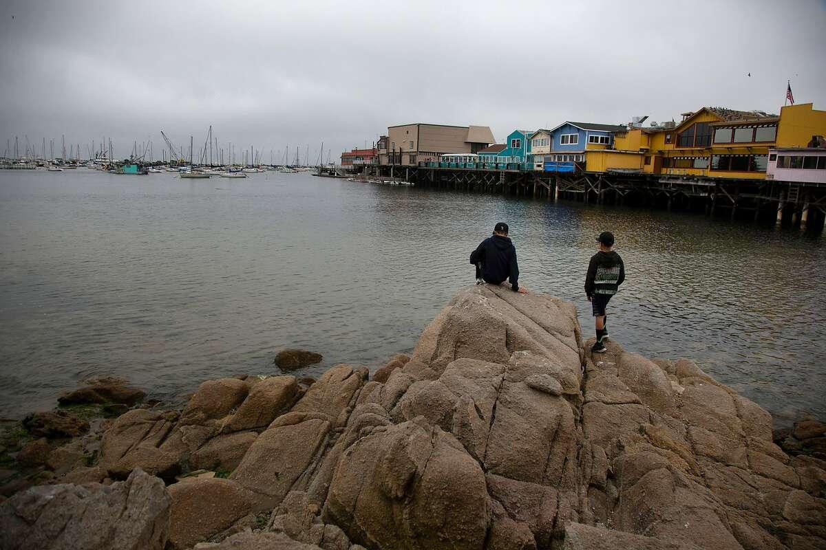 Boys play on the beach on Monday, 7/30, 2018 near Fisherman's Wharf where Spanish explorer Sebastian Vizcaino landed in 1602 in Monterey, California.