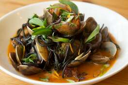 Squid ink spaghetti with manilla clams, pork belly and tanuki cider fermented chili miso broth is one of the menu items offered at Home restaurant on Wednesday, 8/8, 2018 in Soquel, California. Home is one of several Monterey Bay area restaurants recommended by Soerke Peters who is president of the Monterey Bay chapter of American Culinary Federation.