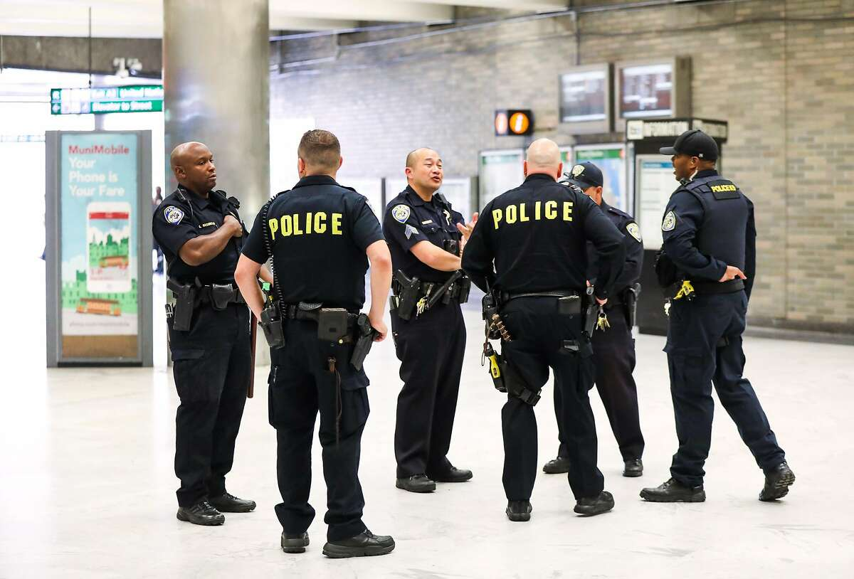 Police chat at they monitor the BART station at Civic Center in San Francisco, California, on Thursday, Aug. 16, 2018.