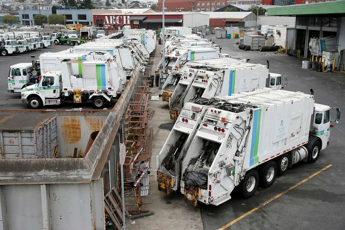 Recycling collection trucks are parked in a Recology maintenance yard on Seventh Street in San Francisco, Calif. on Thursday, Aug. 30, 2018 which it hopes to shut down and develop housing in its place.