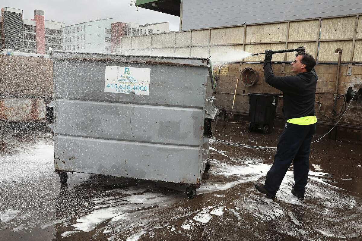 Garbage man Joe Sciamanna on light duty steam cleaning food waste containers at Recology in the 900 7th St. yard on Tuesday, Aug. 28, 2018 in San Francisco, Calif. The solid waste company is seeking to shut down its yard at 7th St.