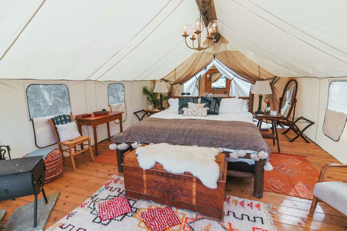 Each of the guest tents at Collective Hill Country are equipped with king beds with 1,500 thread-count linens.