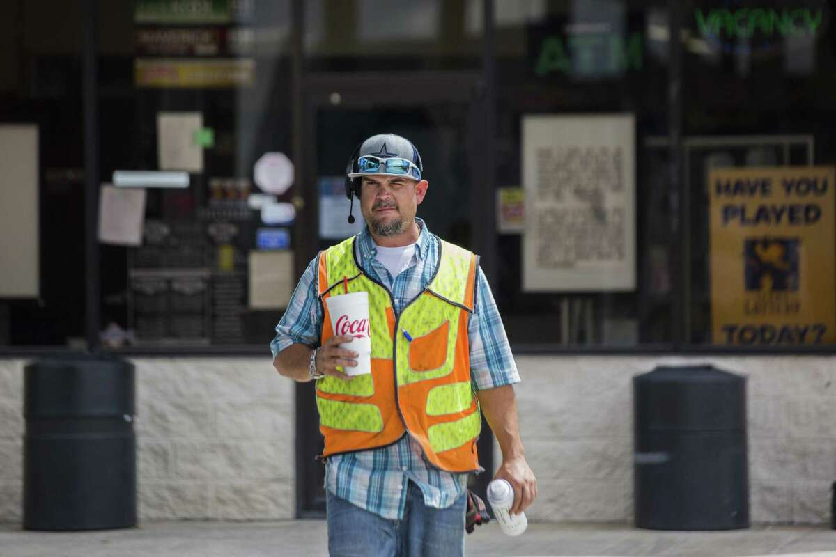 Justin Grande, 40, from Atascocita walks back to his truck after making purchases at the Port Auto Truck Stop convenience store, Monday, Aug. 27, 2018, in La Porte. Grande is a local trucker and a former mechanic. He has kept himself from long haul drives to be able to be present for him family. Grande is a father of four children.