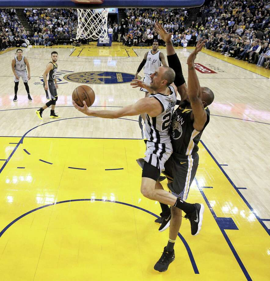 David West tries to defend against a shot by Manu Ginobli, left, in the second half as the Golden State Warriors played the San Antonio Spurs at Oracle Arena in Oakland, Calif., on Feb. 10. Photo: Carlos Avila Gonzalez /The Chronicle / San Francisco Chronicle/Carlos Avila Gonzalez