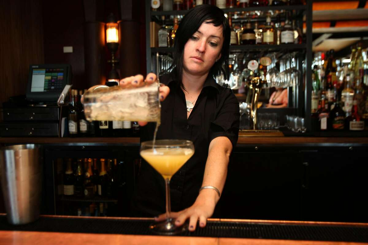 Bar manager Camber Lay of Quiver Bar in San Francisco, Calif., pouring a Conversos cocktail on Friday, April 11. Conversos is pear green tea infused gin, lillet blanc, chartreuse, and lemon. Photo by Liz Hafalia / San Francisco Chronicle