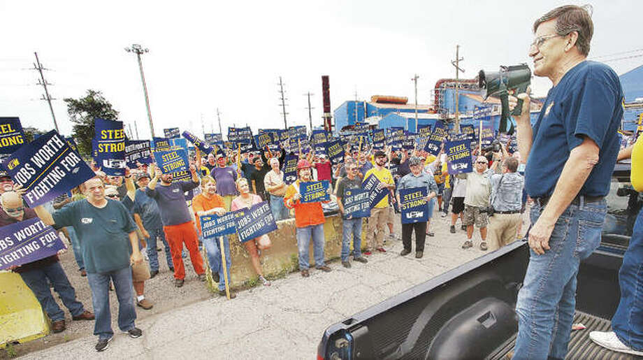 Dave Dowling, director of United Steelworkers of America Sub-district two, speaks to the crowd of more than 200 steelworkers who turned out for a rally outside Granite City Works Thursday. Photo: John Badman | The Telegraph