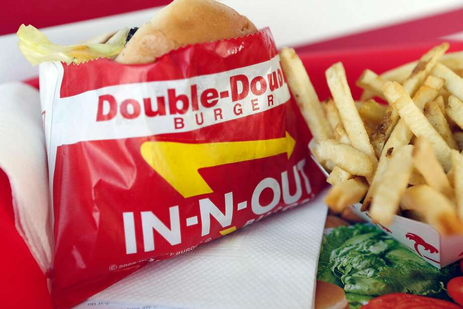 A Double-Double burger and french fries are arranged for a photograph at an In-N-Out Burger restaurant in Costa Mesa, California, U.S., on Wednesday, Feb. 6, 2013.  Photo: Patrick T. Fallon / Bloomberg