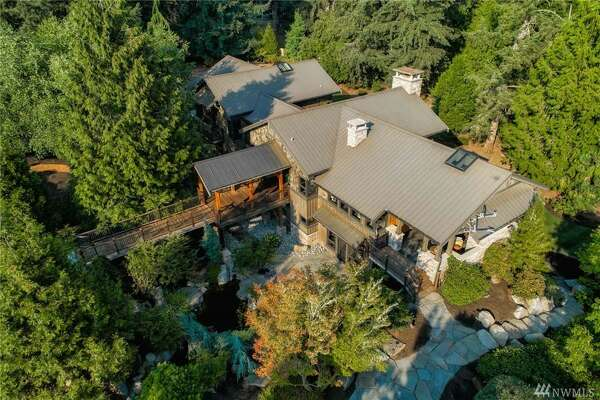 In the country-estate-style lap of luxury is this sprawling Redmond mansion, yours for $3.250M